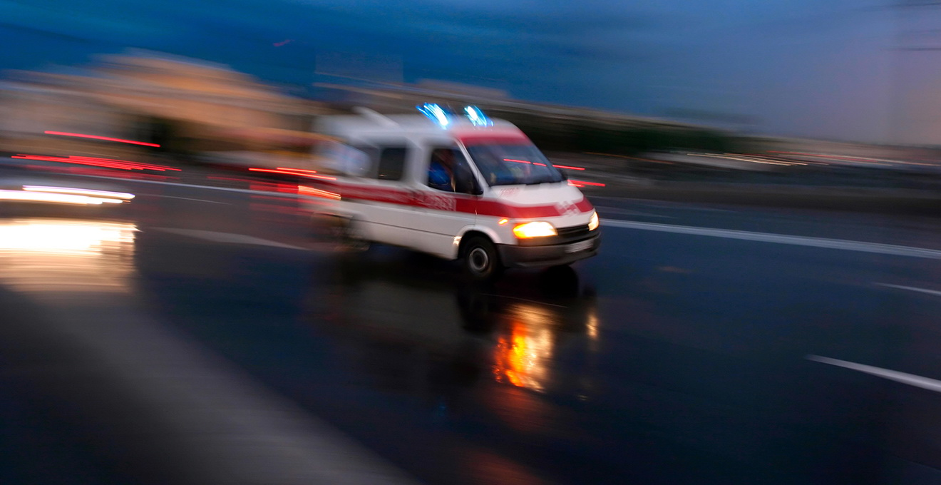 Ambulance car speeding, blurred motion